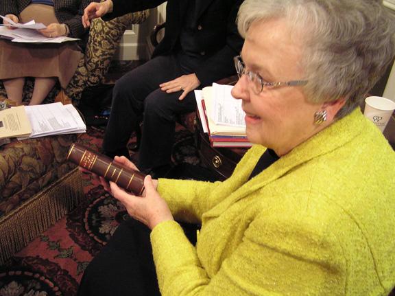 Jean Robbins holding rare book