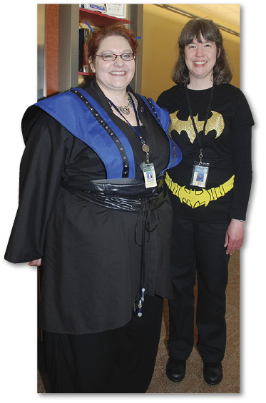 Photo of two library staff dressed in comics costumes