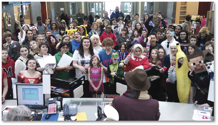 Photo of ~75 attendees, some in costumes