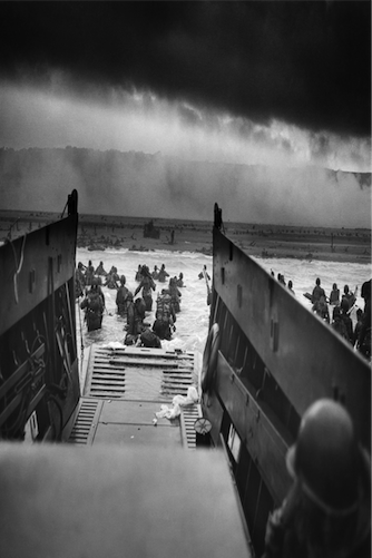 Chief Photographer's Mate Robert F. Sargent, Into the Jaws of Death-U.S. Troops Wading through Water and Nazi Gunfire. 6 June 1944. 2,963 x 2,385 pixels. Stored at the National Archives and Records Administration, Courtesy of Wikimedia Commons.